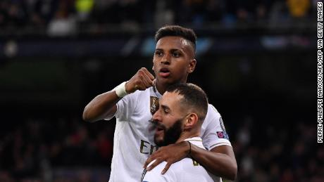 Real Madrid's Karim Benzema (R) celebrates with teammate Rodrygo.