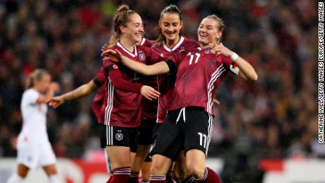 Alexandra Popp of Germany celebrates scoring the opening goal of the friendly against England at Wembley.