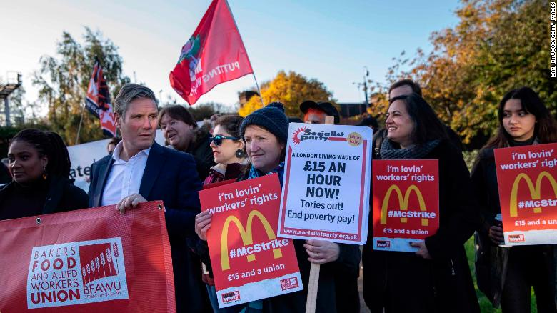 Labour MP Keir Starmer (second from left) joins union members and several McDonald's workers in protest.