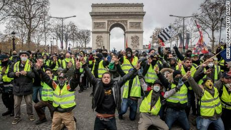 Protesters chant slogans during the  demonstration on the Champs-Elysées near the Arc de Triomphe on December 8, 2018 in Paris.