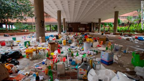 Piles of unused bottles of petrol bombs are seen near one of the entrances to the university.