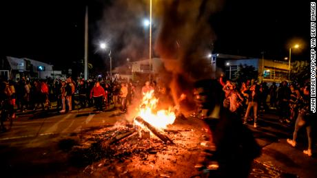 Authorities impose curfew in Bogota after protests turn violent