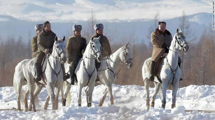 Kim Jong Un is seen riding a horse as he visits Mount Paektu in this KCNA photo.