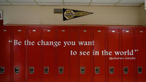 Photos and signs about Mario's case aren't the only calls to action on the walls at Wilbur Cross. A Mahatma Gandhi quote is painted on lockers on the third floor of the school.