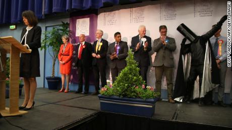 Theresa May (left) and Lord Buckethead (second from right, with the bucket on his head) hear the results in their constituency in 2017.