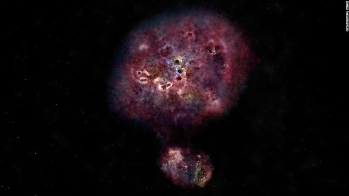 This is an artist's illustration of what MAMBO-9 would look like in visible light. The galaxy is very dusty and it has yet to build most of its stars. The two components show that the galaxy is in the process of merging.