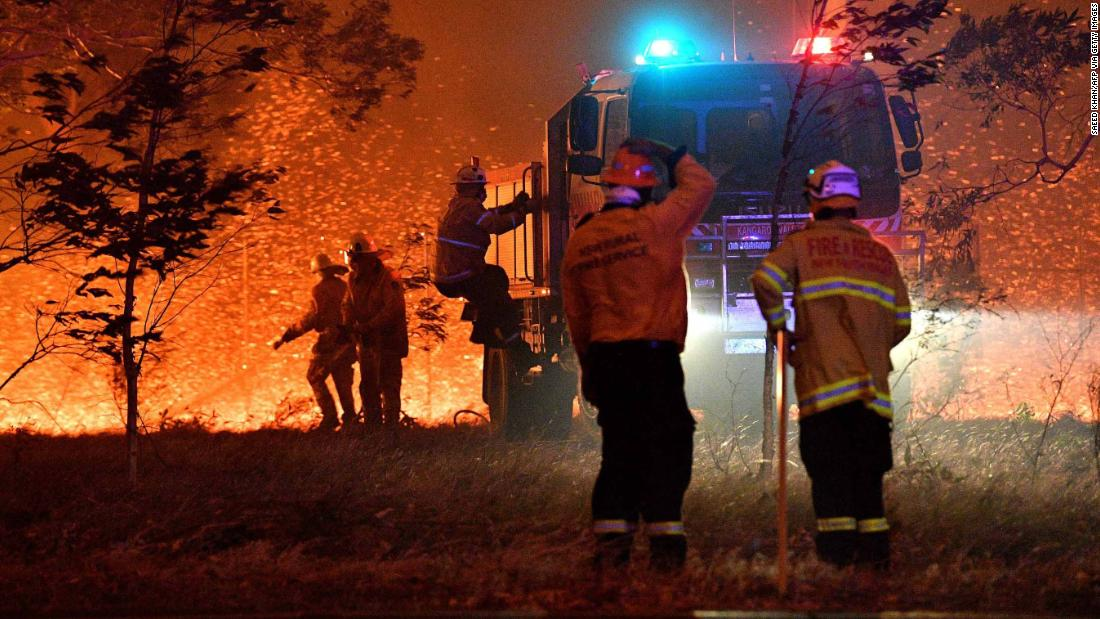 Photo of Australian hearth crew shelter in truck as bushfire rages outdoors