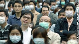 China confirms new coronavirus can spread between humans
