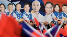 Han Kuo-yu and KMT election candidates seen on posters at a campaign rally in New Taipei City on December 8, 2019.