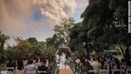 A couple got married while the Taal Volcano erupted in the background.