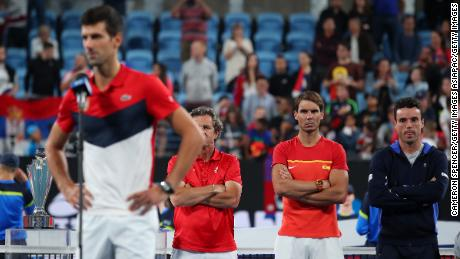 Rafa Nadal watches as Novak Djokovic gives his victory speech after the ATP Cup final.