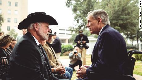 Governor Greg Abbott talks to Jack WIlson before Monday's medal ceremony.