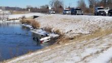 The partially submerged car sits in the frozen pond after Ingraham's rescue.
