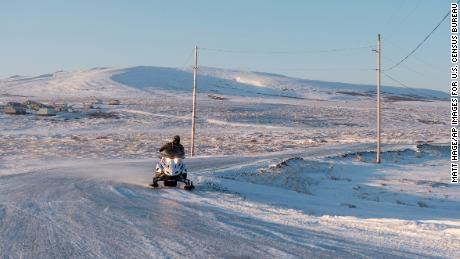 Winter conditions in Toksook Bay make snowmobiles a common form of transportation.
