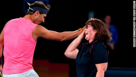 Rafael Nadal celerbates with Australian firefighter Deb Borg.