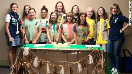 The Girl Scouts from Troop 1980 are pictured with their troop leaders Shae Evans (left) and Lisa McAbee (right).