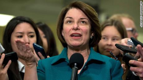 Sen. Amy Klobuchar speaks to reporters on Capitol Hill in Washington, January 21.