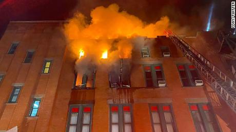 The fire began on the building's fourth floor and spread to the roof, fire officials said.