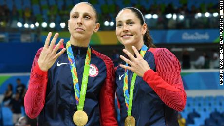 USA pair Diana Taurasi (L) and Sue Bird pose with their gold medals after the final of the women's basketball competition at the Carioca Arena 1 in the 2016 Olympics Games in Rio.