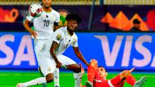 Partey (C) contends the ball with Tunisia striker Taha Yassine Khenissi (R) during the Africa Cup of Nations (CAN) 2019 Round of 16 football match between Ghana and Tunisia at the Ismailia stadium in the Egyptian city on July 8 , 2019.
