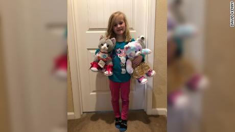 Daphne used the $100 to buy two plush cats from Build-a-Bear.