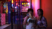 In 2015, two women outside a karaoke bar in Hunchun, in the northeastern province of Jilin in China.