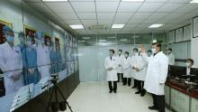 Chinese President Xi Jinping talks to medical staff on duty via a video link at Beijing's Ditan hospital on February 10.