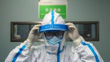 A doctor puts on his isolation suit before entering the negative pressure isolation ward at Jinyintan hospital in Wuhan.