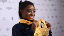 Simone Biles shows off her medal haul at the world championships.