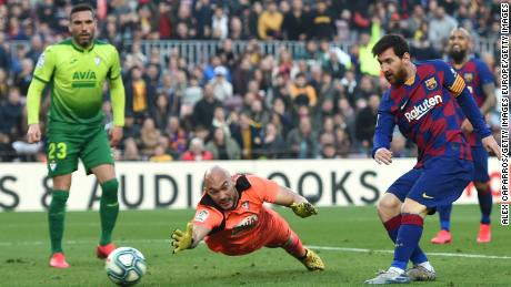 Lionel Messi takes home his fourth goal after a desperate Eibar goalkeeper in the final stages of the 5-0 victory at Camp Nou.