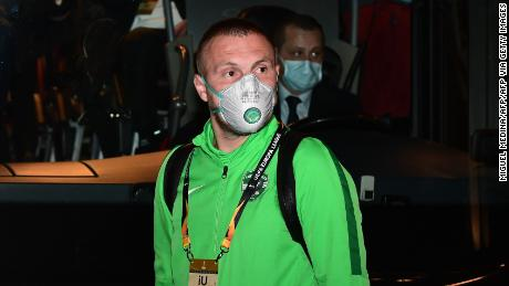 Ludogorets' Romanian defender Cosmin Iosif Moti wears a face mask as he boards the bus on the way to compete in the UEFA Europa League round of 32 against Inter Milan.