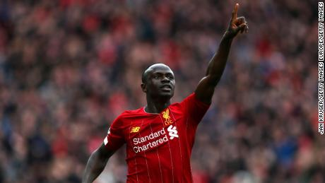 Sadio Mane  celebrates after scoring his team's second goal during the Premier League match between Liverpool FC and AFC Bournemouth  at Anfield on March 07, 2020.