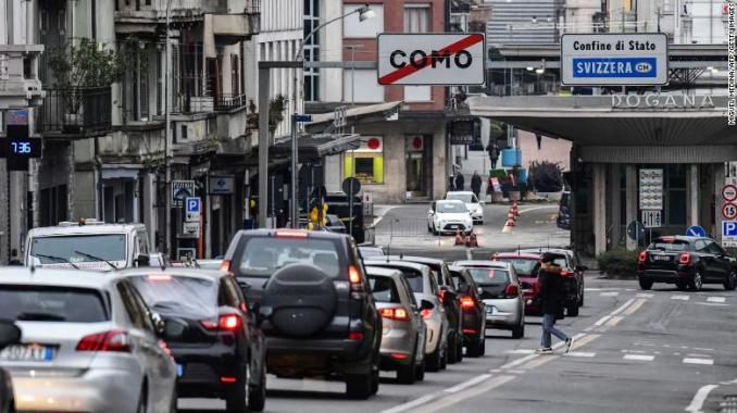 Cars line up to cross the Italy-Switzerland border at the Ponte Chiasso customs post north of Milan, on Monday.