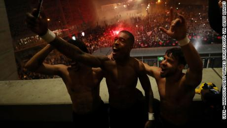PSG players, including Presnel Kimpembe and Juan Bernat, celebrate defeating Borussia Dortmund in the Champions League at the Parc des Princes, a match that was played behind closed doors.