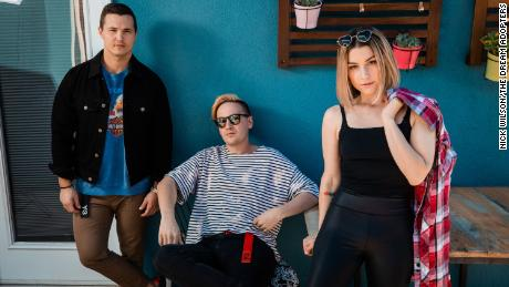 Melanie Fontana, Lindgren (center), and their manager Justin Garza.