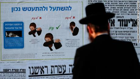 A poster with instructions on how to properly sneeze in Jerusalem on Sunday.