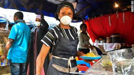 A food seller in Abuja, Nigeria's capital tells CNN she cannot afford to stay at home. Picture by Osaze Efe.