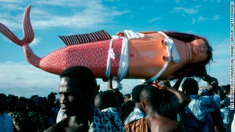 Coffin made and painted to resemble a mermaid for Ga tribal priestess of sea god carried by funeral guests.