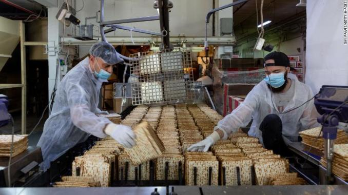 Workers make matzoh for Passover at a factory in Bnei Brak, Israel, on April 07, 2020.