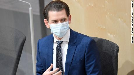 Austria's Chancellor Sebastian Kurz wears a protective mask as he arrives for a special session of the National Council on April 3 in Vienna.