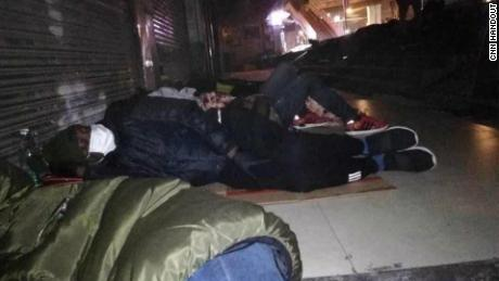 Africans sleeping on the street in Guangzhou, after being unable to find shelter.