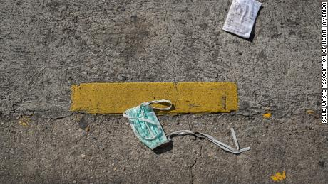 A surgical mask littered on the street.