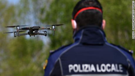 A police officer pilots a DJI Mavic 2 Enterprise drone with a thermal sensor to check people's temperature on April 9 in Treviolo, near Bergamo, Italy.