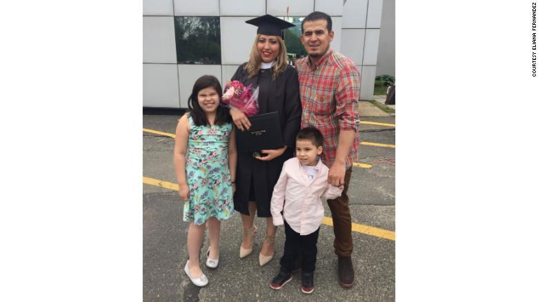 Fernandez poses with her family after graduation.