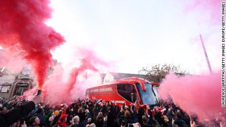 Liverpool fans let of smoke flares as their team coach arrives at the stadium prior to the Premier League match between Liverpool FC and Manchester City at Anfield on November 10, 2019.