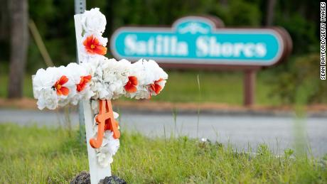 "A cross with flowers and a letter ""A"" sits at the entrance to the Satilla Shores neighborhood where Ahmaud Arbery was shot and killed in Brunswick, Georgia."
