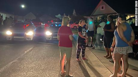 Neighbors and police gather after the group arrived at the Shepards' home in Pender County on May 3.