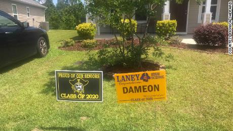 A sign congratulating Dameon Shepard on his high school graduation sits on the family's lawn in May.
