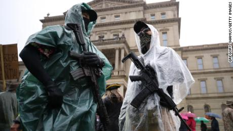In this May 14, 2020, file photo, protesters carrying weapons -- angry at Gov. Gretchen Whitmer for  stay-at-home orders related to the coronavirus -- gather at the Michigan Capitol in Lansing.
