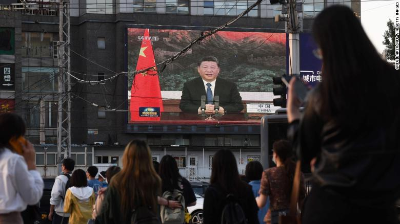 Chinese President Xi Jinping speaking via video link to the World Health Assembly on a giant screen beside a street in Beijing on May 18.